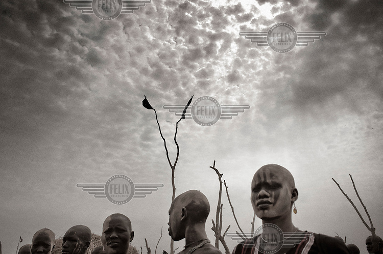 South Sudan. 23 March 2011...Young Dinkas in a cattle camp near the Nile. His face is covered with ashes from burned cows' droppings..