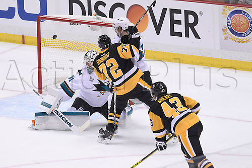 30.05.2016. Pittsburgh, PENN, USA.  Pittsburgh Penguins left wing Conor Sheary (43) scores past San Jose Sharks goalie Martin Jones (31) during the first period of Game One in the 2016 NHL Stanley Cup Final between the San Jose Sharks and the Pittsburgh Penguins at the Consol Energy Center in Pittsburgh, Pennsylvania.   The Penguins scores late in the game for a 3-2 home win.