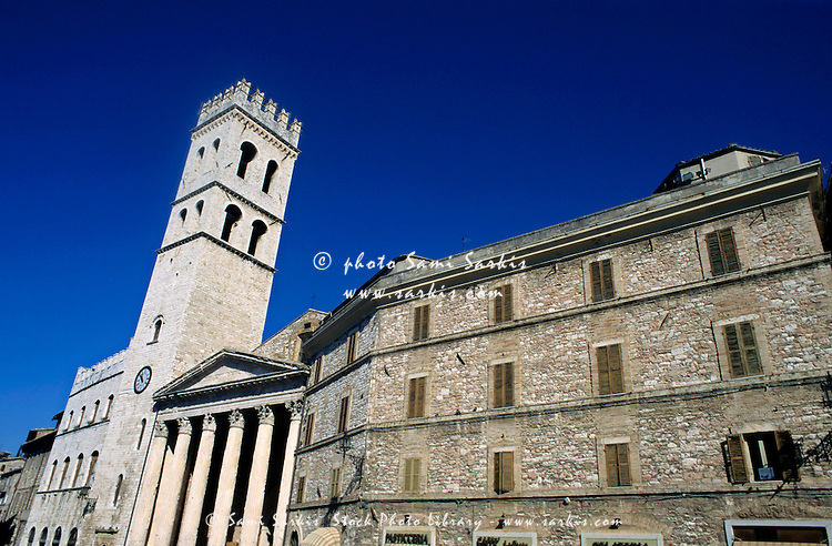 Bell tower and columns of the church once the Temple of Minerva, Assisi, Italy.