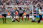 Grimsby Town players look dejected after defeat in the 2015 Vanarama Conference Promotion Final match between Grimsby Town and Bristol Rovers at Wembley Stadium, London<br /> Picture by David Horn/eXtreme aperture photography +44 7545 970036<br /> 17/05/2015