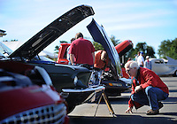 NWA Democrat-Gazette/ANDY SHUPE<br /> Aaron Hobart of Farmington reads Saturday, Sept. 12, 2015, a display describing the particulars of a 1968 Ford Mustang GT coupe owned by Tony Bass on display at the annual Elkins Fun Day car and bike show at the Elkins Community Center. The day included a pellet gun shooting competition, bingo, music, food, crafts and fireworks.