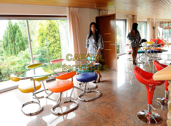 **Exclusive Pictures**.SOFIA HAYAT.Pictured At Her Home In West Kingsdown, Kent, 28th August 2009..full length interior house inside chairs retro class table dining area kitchen bar stools property mirror silver snakeskin print animal dress .CAP/FIN.©Steve Finn/Capital Pictures