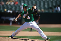 OAKLAND, CA - JULY 17:  Homer Bailey #15 of the Oakland Athletics pitches against the Seattle Mariners during the game at the Oakland Coliseum on Wednesday, July 17, 2019 in Oakland, California. (Photo by Brad Mangin)