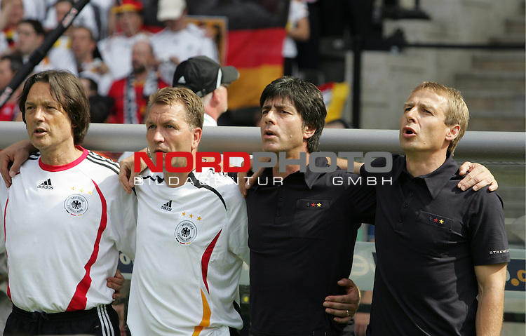 FIFA WM 2006 - Gruppe A ( Group A )<br /> Play #33 (20-Jun) - Ecuador vs Germany.<br /> Team doctor Hans-Wilhelm-M&cedil;ller- Wohlfahrt, Goalkeeper-Coach Andreas K&circ;pke, Coach Joachim L&circ;w and Coach J&cedil;rgen Klinsmann (l-r) from Germany sing the national anthem prior to the match of the World Cup in Berlin.<br /> Foto &copy; nordphoto