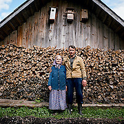 Babka Valya and her son Serguei, aged 33. He does odd jobs about the village, gives a hand with carpentry and can dig a hole here and there. .