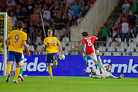 Sweden's goalkeeper Andreas Isaksson (R), Kim Kallstrom (L) and Oscar Wendt (2nd L) fight for the ball with Hungary's Gergely Rudolf (2nd R) during the UEFA EURO 2012 Group E qualifier Hungary playing against Sweden in Budapest, Hungary on September 02, 2011. ATTILA VOLGYI