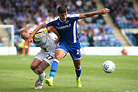 Alfie Jones of Gillingham shields the ball from Burton's Liam Boyce during Gillingham vs Burton Albion, Sky Bet EFL League 1 Football at The Medway Priestfield Stadium on 10th August 2019