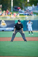 1B Umpire Cody Oakes handles the calls on the bases during the game between the Salt Lake Bees and the Round Rock Express at Smith's Ballpark on June 10, 2019 in Salt Lake City, Utah. The Bees defeated the Express 9-7. (Stephen Smith/Four Seam Images)