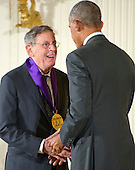 United States President Barack Obama presents the 2015 National Medal of Arts to Philip Glass, Composer of New York, New York during a ceremony in the East Room of the White House in Washington, DC on Thursday, September 22, 2016.<br /> Credit: Ron Sachs / CNP