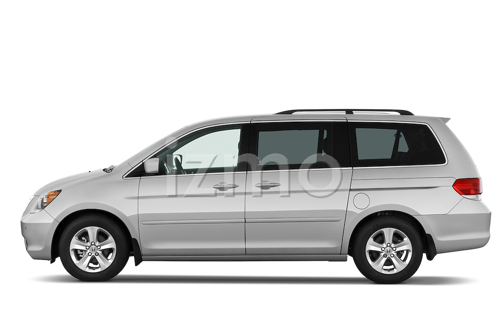 Driver side profile view of a 2009 Honda Odyssey Touring.