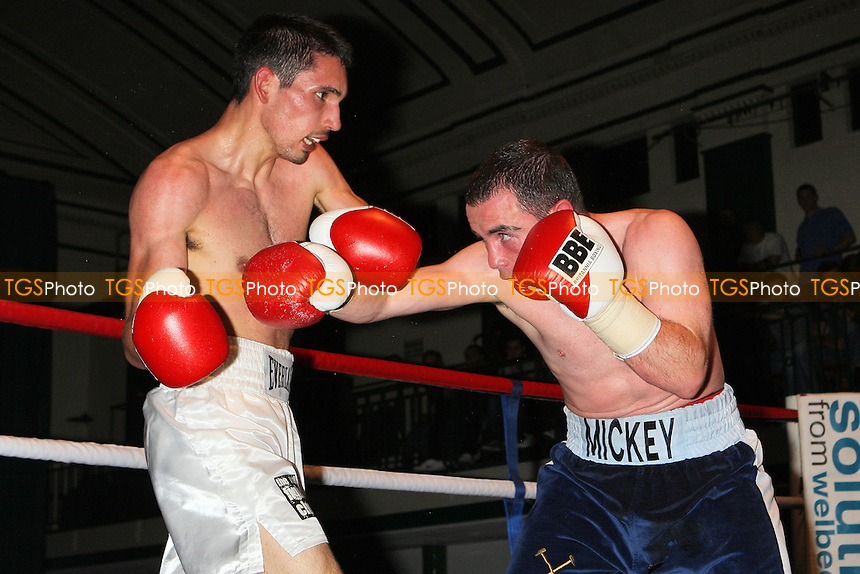 Mickey Coveney (blue shorts) defeats Alex Dilmaghani (white shorts) in a Lightweight boxing contest at York Hall, Bethnal Green, promoted by Spencer Fearon/HardKnocks - 18/06/11 - MANDATORY CREDIT: Gavin Ellis/TGSPHOTO - Self billing applies where appropriate - Tel: 0845 094 6026