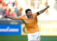 Brian Ching (25) of the Houston Dynamo celebrates the first goal of the game during the game at PPL Park in Chester, PA.  Houston defeated Philadelphia, 2-1, to take home the one goal advantage in the home and home series..