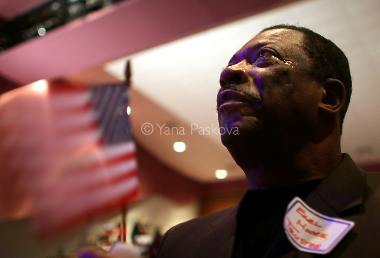 "Earl Moore, 64, on the Board of Trustees for DuSable, from Chicago, cries while watching the inauguration of Barack Obama as President of the United States in the theater of the DuSable Museum of African-American History in Chicago, Illinois, on the Presidential Inauguration Day, Tuesday, January 20, 2009.  Camara said, ""I expect Obama to stay grounded, spiritually, mentally, and physically, because a lot in his job will be overwhelming, but as long as he stays grounded, he will be okay."" Camara's phone number: 773.239.1771 (Photo by Yana Paskova for The New York Times)..Assignment ID: 30075164A"