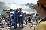 Niagara Falls, Ontario, Canada - 01 August 2006---Tourists / visitors  taking each others photo at Niagara River with the American Falls on the United States' side---nature, landscape, people, tourism, photography---Photo: © HorstWagner.eu