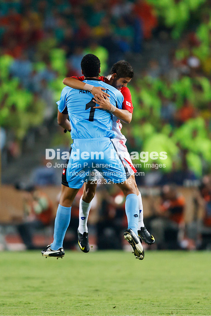 CAIRO - OCTOBER 6:  Costa Rica goalkeeper Esteban Alvarado and teammate Cristian Gamboa celebrate after a goal against Egypt during the FIFA U-20 World Cup round of 16 match at Cairo International Stadium on October10, 2009 in Cairo, Egypt.  Editorial use only.  Commercial use prohibited.  (Photograph by Jonathan P. Larsen)
