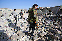 Photographer: Rick Findler/Borderline News..17.01.13 Soldiers belonging to the Free Syrian Army (FSA) attempt to have a closer look at Minnagh Military Airport as they plan an offensive attack to take the airport from Assad control outside of Aleppo, Northern Syria.