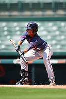 GCL Twins left fielder Jean Carlos Arias (1) lays down a bunt during a game against the GCL Orioles on August 11, 2016 at the Ed Smith Stadium in Sarasota, Florida.  GCL Twins defeated GCL Orioles 4-3.  (Mike Janes/Four Seam Images)