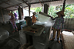 Women make rice noodles at a small factory in the Mekong Delta, south of Can Tho, Vietnam. Sept. 30, 2011.