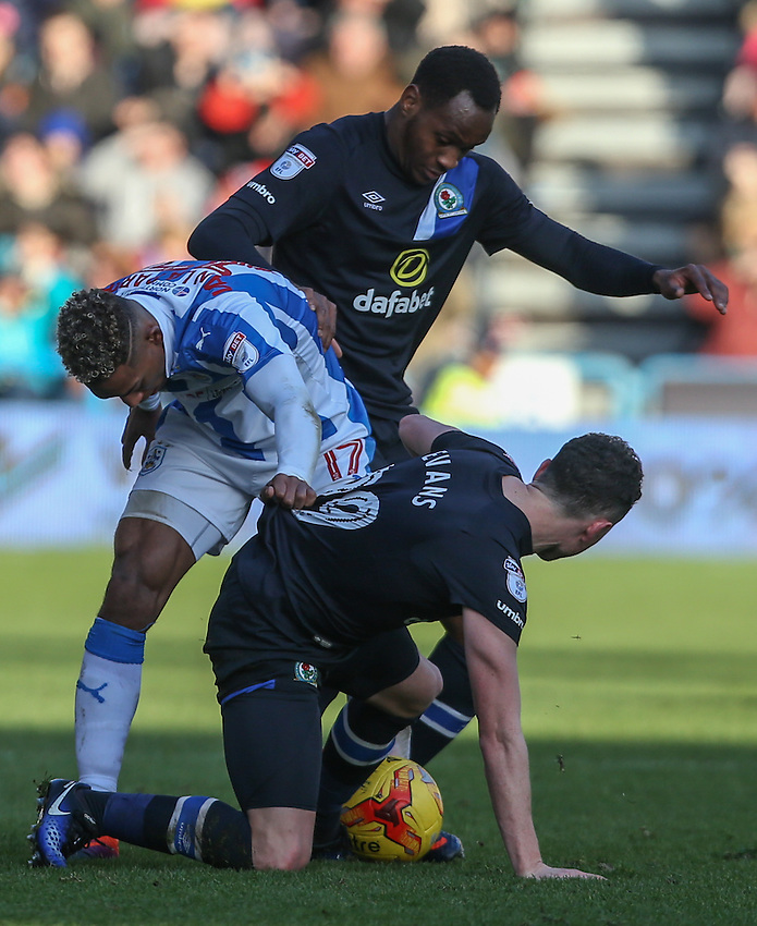 Blackburn Rovers' Corry Evans is tackled by Huddersfield Town's Rajiv van La Parra<br /> <br /> Photographer Alex Dodd/CameraSport<br /> <br /> The EFL Sky Bet Championship - Huddersfield Town v Blackburn Rovers - Saturday 31st December 2016 - The John Smith's Stadium - Huddersfield<br /> <br /> World Copyright &copy; 2016 CameraSport. All rights reserved. 43 Linden Ave. Countesthorpe. Leicester. England. LE8 5PG - Tel: +44 (0) 116 277 4147 - admin@camerasport.com - www.camerasport.com
