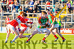 Luke McLarnon Daingean Uí Chúis tackles Caolim Teehan Mid Kerry  during the County Minor championship final in Fitzgerald Stadium on Sunday
