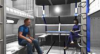 The 3D model of the Living Module. Rosa and James Corrigan (Sharlto Copley) having a conversation.