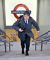 Boris Johnson - man in a hurry - he sprints up several flights of stairs at the Underground in full cycle helmet, coat and rucksack - after the engagement....Johnson was at the opening of new ticket hall at London's King Cross Underground Station..Johnson was at the opening of new ticket hall at London's King Cross Underground Station...Picture by Gavin Rodgers/ Pixel 07917221968