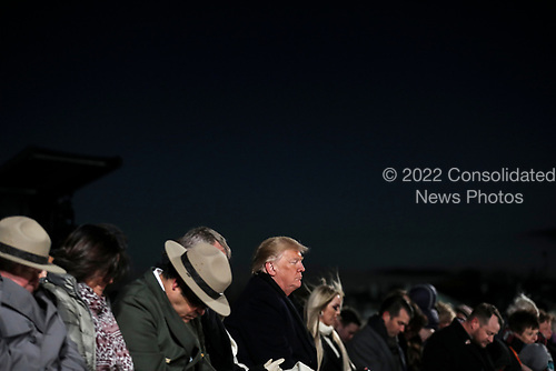 United States President Donald J. Trump, center, prays during the 2018 National Christmas Tree lighting ceremony at the Ellipse near the White House in Washington, DC on November 28, 2018. <br /> Credit: Oliver Contreras / Pool via CNP