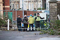 Pictured: Police arrest a climate protester who chained himself onto a tree in Cardiff, Wales, UK.<br /> Re: A man was arrested following a stand-off between developers and climate change protesters over the felling of two 150-year-old trees in the Canton area of Cardiff, Wales, UK.<br /> More than 100 protesters gathered at Suffolk House on Sunday to stop the lime and copper beech trees being chopped down.<br /> An Extinction Rebellion campaigner chained himself to one of the trees, but he was later lifted down.<br /> A local man, aged 49, was arrested on suspicion of aggravated trespass.<br /> South Wales Police said on Monday morning that he remained in custody.