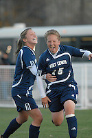 Kim Sisneros of Fort Lewis College (15) celebrates after her goal at Metro State in Denver, Colorado on November 2, 2007. Erika Schisler, left, shares the celebration. Fort Lewis won the match and became the RMAC champions in 2007.