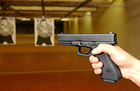 2001 File Photo, Montreal, Quebec, Canada; <br /> <br /> A Quebec provincial police (Surete du Quebec) officer demonstrate a GLOCK 9 mm handgun at the Police firing range in Montreal<br /> <br /> (Mandatory Credit: Photo by Sevy - Images Distribution (©) Copyright 2002 by Sevy<br /> <br /> NOTE :  D-1 H original JPEG, saved as Adobe 1998 RGB.<br />  Uncompressed and uncropped original  size file available on request.