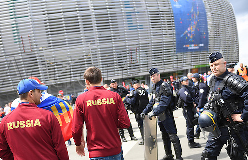 15.06.2016. Lille, France.  Russian supporters pass French policemen as they arrive at the stadium before the UEFA Euro 2016 Group B soccer match Russia and Slovakia at Stade Pierre Mauroy in Lille Metropole, France, 15 June 2016.