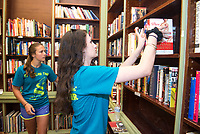 Emma Kiely,'21, right, and Claire Wulfman,'21, scan and organize books at the Redwood Library as they participate in the Salve Regina University Exploration Day of Service in Newport.