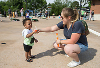 Judson Otabil, 18 mo., plays in bubbles Friday, June 19, 2020, with his mom Lindsey Otabil of Bentonville during a Juneteenth cookout at Lawrence Plaza in Bentonville. Go to nwaonline.com/200620Daily/ to see more photos.<br /> (NWA Democrat-Gazette/Ben Goff)