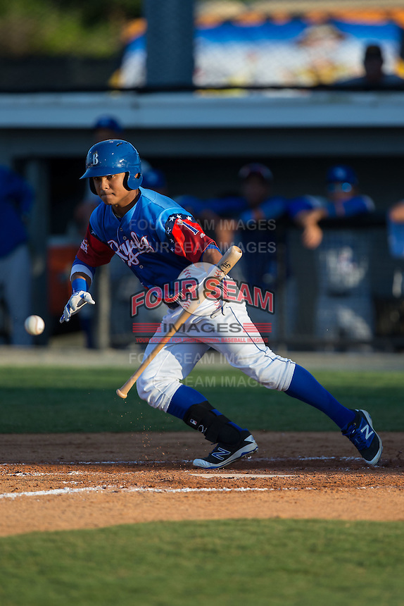 Cristhian Vasquez (44) of the Burlington Royals attempts to lay down a bunt during the game against the Bluefield Blue Jays at Burlington Athletic Stadium on June 26, 2016 in Burlington, North Carolina.  The Blue Jays defeated the Royals 4-3.  (Brian Westerholt/Four Seam Images)