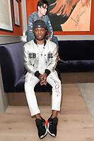"Fashion designer Christopher Lowman poses during his Christopher Lowman Spring Summer 2018 ""Harvard Punk'd"" collection fashion pesentation at HGU New York, on July 10, 2017; during New York Fashion Week: Men's Spring Summer 2018."