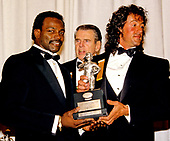 Chicago Bears running back Walter Payton (34), left, and American actor, director, screenwriter, and producer Sylvester Stallone, right, hold the Timmie Award, hold the trophy to be presented to defensive tackle Chad Hennings of the United States Air Force Academy, the 1987 College Lineman of the Year.  The award is presented in the memory of Knute Rockne by the Washington, DC Touchdown Club in Washington, DC on January 23, 1988.  At center is former Washington Redskins head coach George Allen.<br /> Credit: Arnie Sachs / CNP
