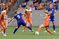 Allysha Chapman (15) of the Houston Dash and Josée Bélanger (9) of the Orlando Pride battle for control of the ball on Friday, May 20, 2016 at BBVA Compass Stadium in Houston Texas. The Orlando Pride defeated the Houston Dash 1-0.