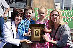 Lynn McDonnell (left) with her daughter Miryiam and grandchildren Oisín McKenna and Juliette Jackson with a photo of John Charles Lougheed who fought in WW1 and died in 1924 and is buried in St. Mary's graveyard. <br /> <br /> (phone Lynn on 087 7560066 for full details). Picture: www.newsfile.ie
