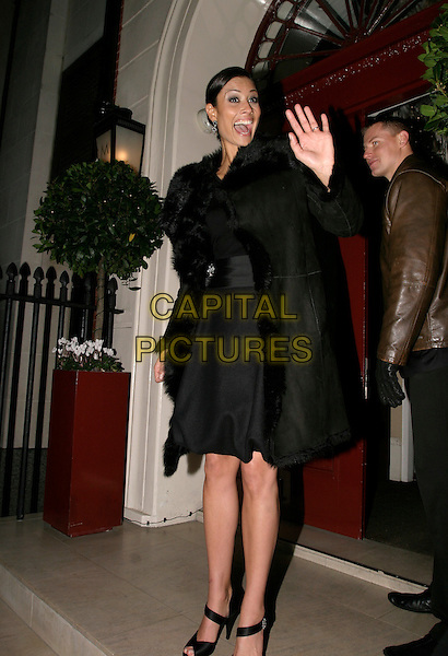 MELANIE SYKES.Afterparty of Gala Screening of George Michael: A Different Story at Morton's, Berkeley Square, London, UK..December 5th, 2005.Ref: AH.full length black coat waving gesture hand waving.www.capitalpictures.com.sales@capitalpictures.com.© Capital Pictures.