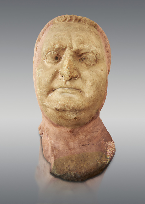 Roman sculpture of the Emperor Vitellius, excavated  from Althiburos sculpted circa 20 April 69-20 Dec 69AD. The Bardo National Museum, Tunis, Inv No: C.1784.   Against a grey background.