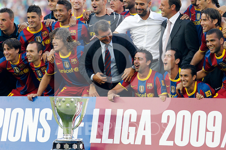FC Barcelona's players, ex president Joan Laporta, new President Sandro Rosell and the coach Pep Guardiola with the Trophy of Champions in La Liga 2009-2010 during Joan Gamper Trophy. August 25,2010. (ALTERPHOTOS/Acero)