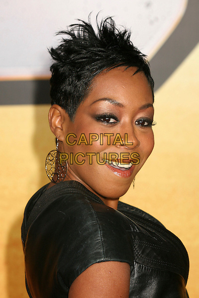 "TICHINA ARNOLD.""Wild Hogs"" Los Angeles Premiere at the El Capitan Theatre, Hollywood, California, USA..February 27th, 2007.headshot portrait earrings .CAP/ADM/BP.©Byron Purvis/AdMedia/Capital Pictures"