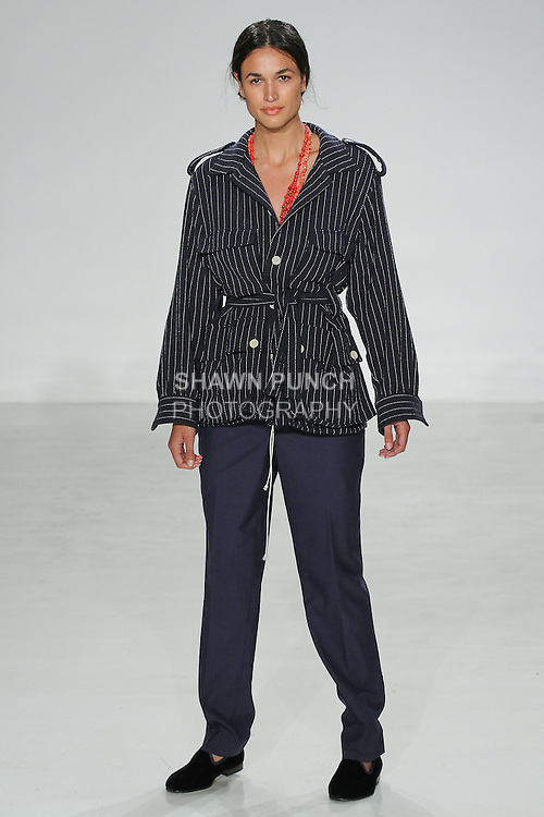 Model walks runway in a navy stripe safari jacket and tab flat front trouser from the Palmiers du Mal Spring Summer 2017 collection by Brandon Capps and Shane Fonner, at Skylight Clarkson Square on July 14 2016, during New York Fashion Week Men's Spring Summer 2017.
