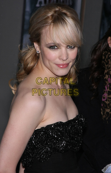 "RACHEL McADAMS .New York Premiere of ""Sherlock Holmes"" held at the Starr Theater at Alice Tully Hall, Lincoln Center, NY, USA, December 17th 2009..portrait headshot black strapless fringe smiling .CAP/LNC/TOM.©LNC/Capital Pictures"