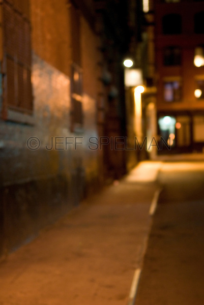 Defocused View of a Dark Alley at Night, Lower Manhattan, New York City, New York State, USA<br /> <br /> AVAILABLE FOR COMMERCIAL OR EDITORIAL LICENSING FROM GETTY IMAGES.  Please go to www.gettyimages.com and search for image # 158771972.