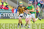 Abbeydorney's Kieran Hanafin gets away from Lixnaw's Kenny Waltz in the hurling county championship at Austin Stack park, Tralee on Saturday.