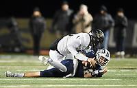 NWA Democrat-Gazette/CHARLIE KAIJO Bentonville West quarterback Dalton Mcdonald (12) takes a sack, Friday, November 8, 2019 during a football game at Bentonville West High School in Centerton.