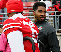 Injured players Ohio State Buckeyes cornerback Marshon Lattimore (2) and quarterback Braxton Miller (5) walk on to the field for Saturday's NCAA Division I football game between the Ohio State Buckeyes and the Rutgers Scarlet Knights at Ohio Stadium in Columbus on Saturday, Oct. 18, 2014. (Dispatch Photo by Barbara J. Perenic)