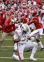 Arkansas Democrat-Gazette/BENJAMIN KRAIN --10/24/2015--<br /> The Razorbacks celebrate a 4 OT victory over Auburn after  Auburn receiver Ricardo Louis , center, dropped a fourth down pass.