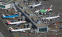 aerial photograph of the aircraft parked at gates at the international terminal of San Francisco International airport (SFO), San Francisco, California including Air France, British Airways, El Al Israel Airlines, Japan Airlines (JAL) and KLM